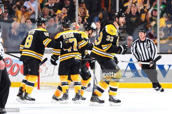 Zdeno Chara of the Boston Bruins celebrate a goal against the Detroit Red Wings in Game Five of the First Round of the 2014 Stanley Cup Playoffs at...
