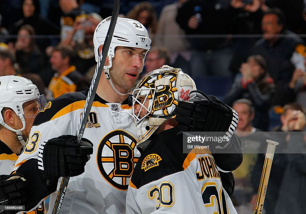 <a gi-track='captionPersonalityLinkClicked' href=/galleries/search?phrase=Zdeno+Chara&family=editorial&specificpeople=203177 ng-click='$event.stopPropagation()'>Zdeno Chara</a> #33 of the Boston Bruins celebrates Boston's 5-2 victory over the the Buffalo Sabres with goaltender Chad Johnson #30 on October 23, 2013 at the First Niagara Center in Buffalo, New York.