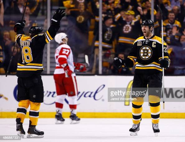 Zdeno Chara of the Boston Bruins celebrates his goal at the end of the second period with teammate Reilly Smith against the Detroit Red Wings in Game...