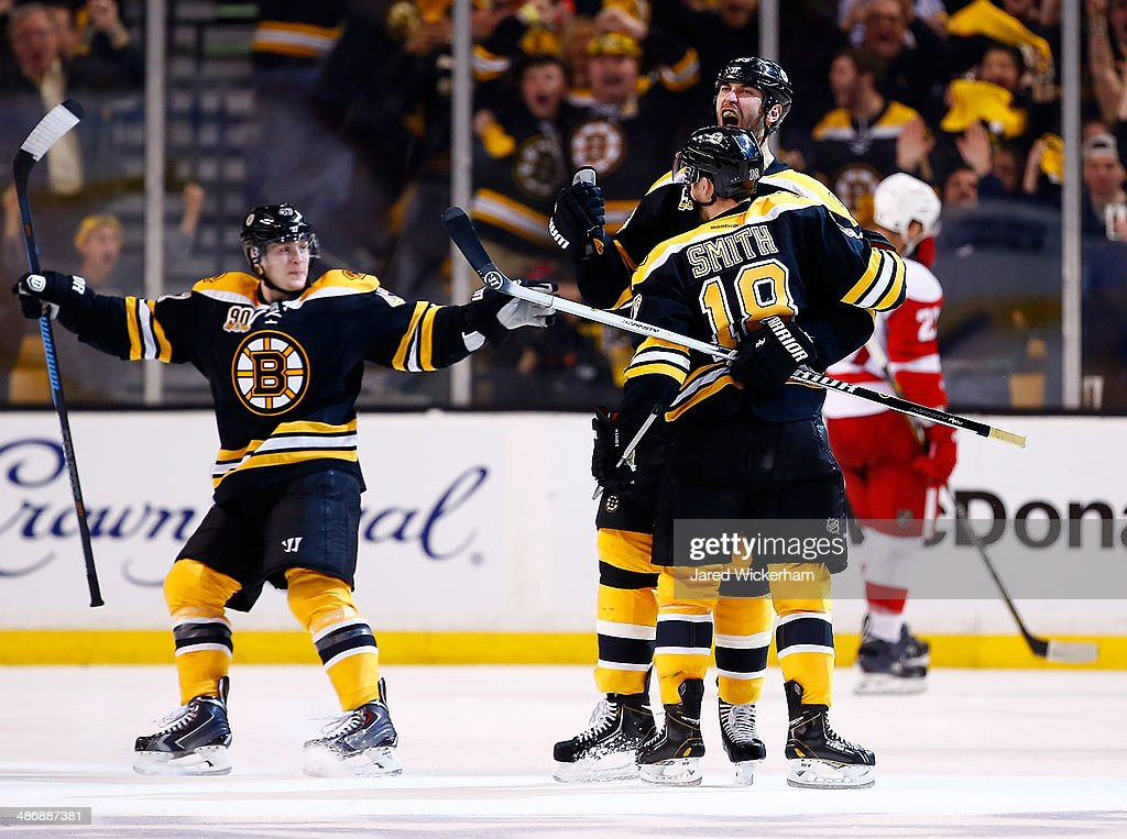 <a gi-track='captionPersonalityLinkClicked' href=/galleries/search?phrase=Zdeno+Chara&family=editorial&specificpeople=203177 ng-click='$event.stopPropagation()'>Zdeno Chara</a> #33 of the Boston Bruins celebrates his goal at the end of the second period with teammates Reilly Smith #18 and <a gi-track='captionPersonalityLinkClicked' href=/galleries/search?phrase=Torey+Krug&family=editorial&specificpeople=6670036 ng-click='$event.stopPropagation()'>Torey Krug</a> #47 against the Detroit Red Wings in Game Five of the First Round of the 2014 NHL Stanley Cup Playoffs at TD Garden on April 26, 2014 in Boston, Massachusetts.