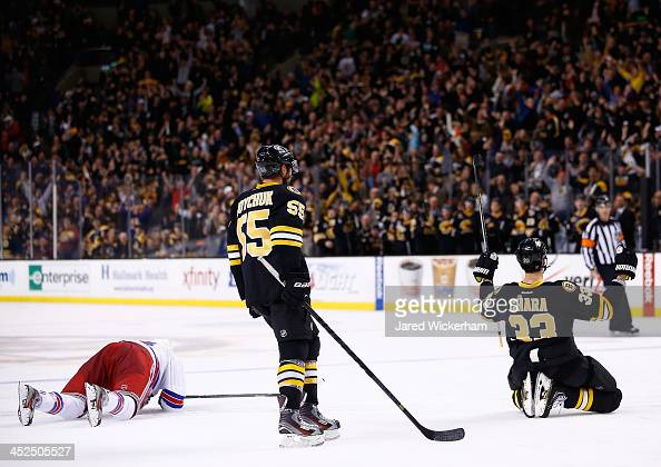 Zdeno Chara of the Boston Bruins celebrates his goal in the third period in front of teammate Johnny Boychuk against the New York Rangers during the...