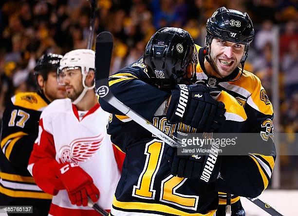 Zdeno Chara of the Boston Bruins celebrates his goal with teammate Jarome Iginla in the third period against the Detroit Red Wings during the game at...