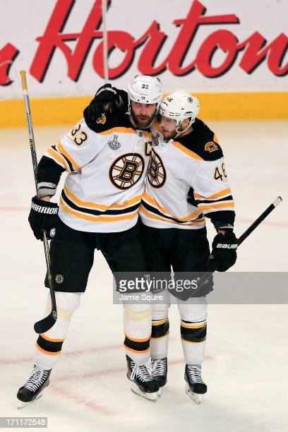 Zdeno Chara of the Boston Bruins celebrates with his teammates David Krejci after Chara scored a goal in the third period against Corey Crawford of...