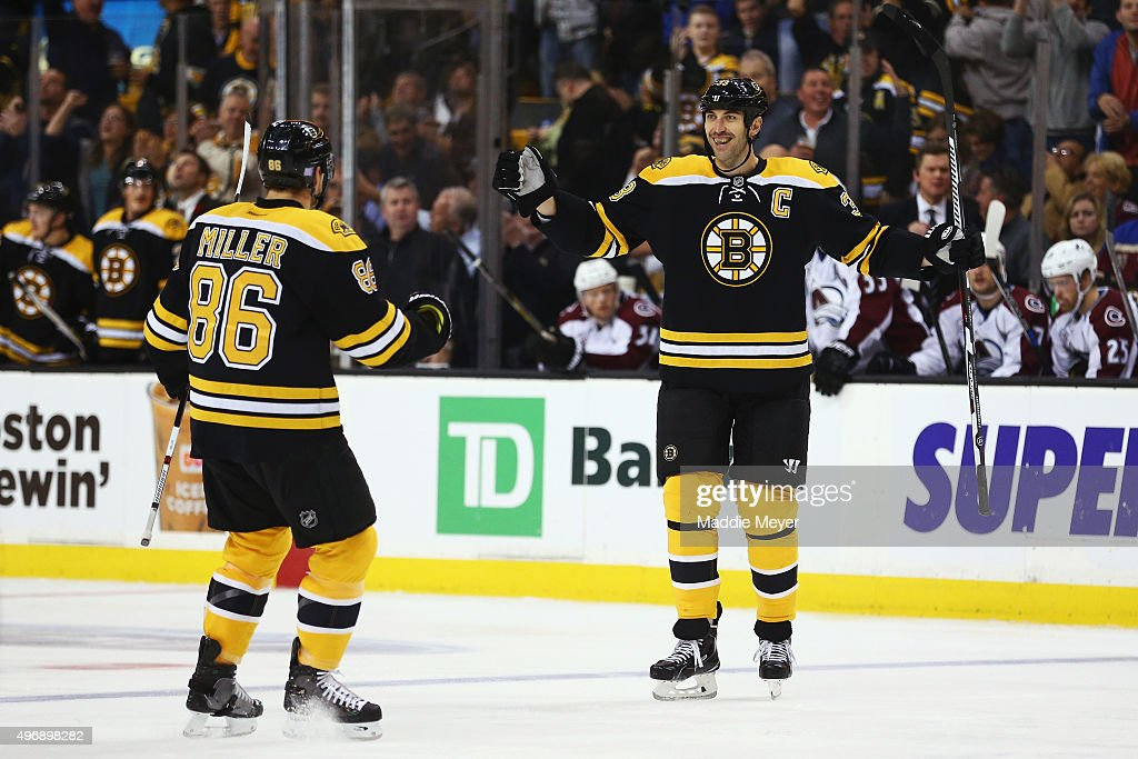 <a gi-track='captionPersonalityLinkClicked' href=/galleries/search?phrase=Zdeno+Chara&family=editorial&specificpeople=203177 ng-click='$event.stopPropagation()'>Zdeno Chara</a> #33 of the Boston Bruins celebrates with <a gi-track='captionPersonalityLinkClicked' href=/galleries/search?phrase=Kevan+Miller&family=editorial&specificpeople=8236132 ng-click='$event.stopPropagation()'>Kevan Miller</a> #86 after scoring a goal against the Colorado Avalanche during the first period at TD Garden on November 12, 2015 in Boston, Massachusetts.