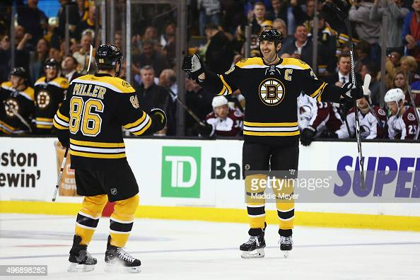 Zdeno Chara of the Boston Bruins celebrates with Kevan Miller after scoring a goal against the Colorado Avalanche during the first period at TD...