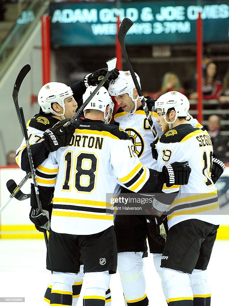 Zdeno Chara #33 of the Boston Bruins celebrates with teammates after scoring a first period goal against the Carolina Hurricanes at PNC Arena on January 28, 2013 in Raleigh, North Carolina.