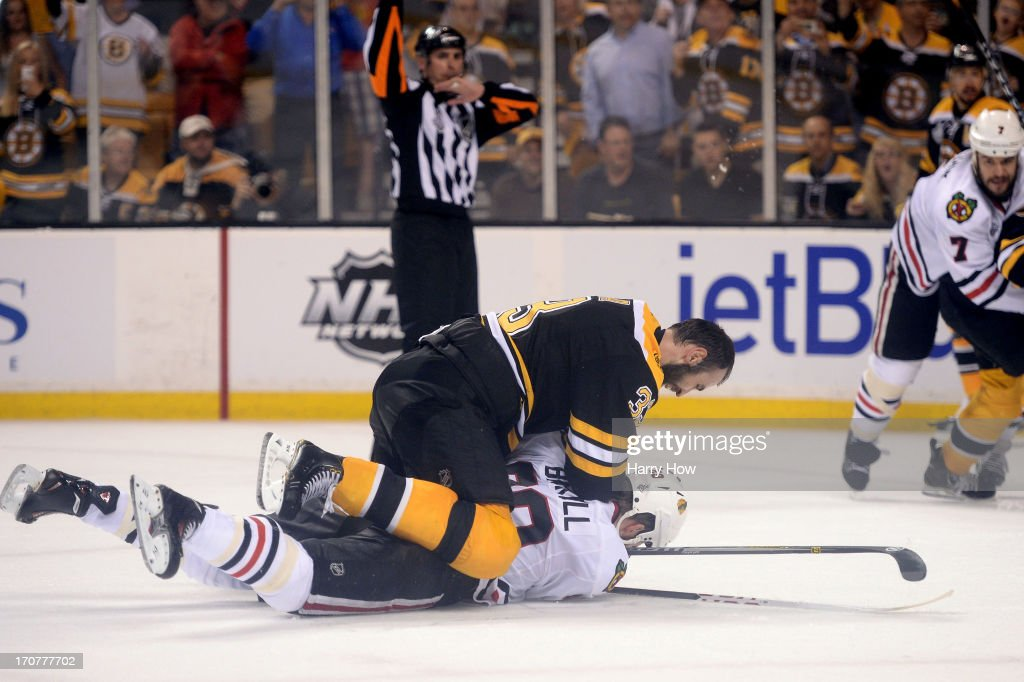 Zdeno Chara #33 of the Boston Bruins checks Bryan Bickell #29 of the Chicago Blackhawks to the ice late in the game in Game Three of the 2013 NHL Stanley Cup Final at TD Garden on June 17, 2013 in Boston, Massachusetts.