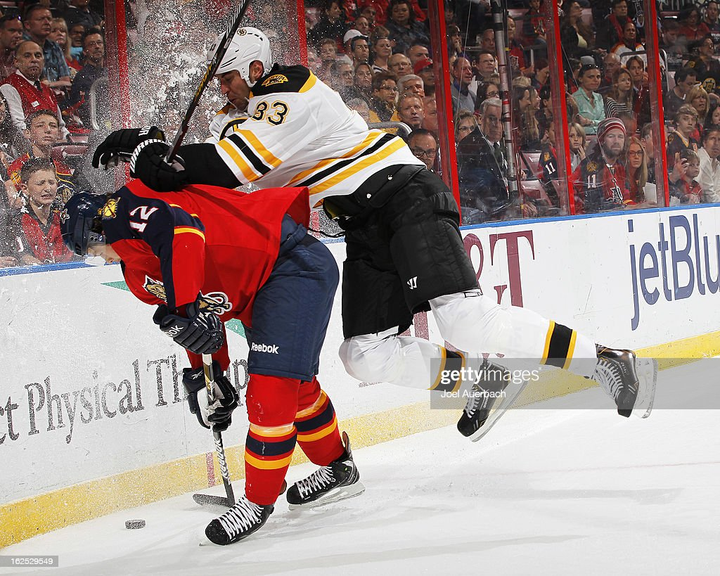 Zdeno Chara #33 of the Boston Bruins checks Jack Skille #12 of the Florida Panthers into the boards at the BB&T Center on February 24, 2013 in Sunrise, Florida.