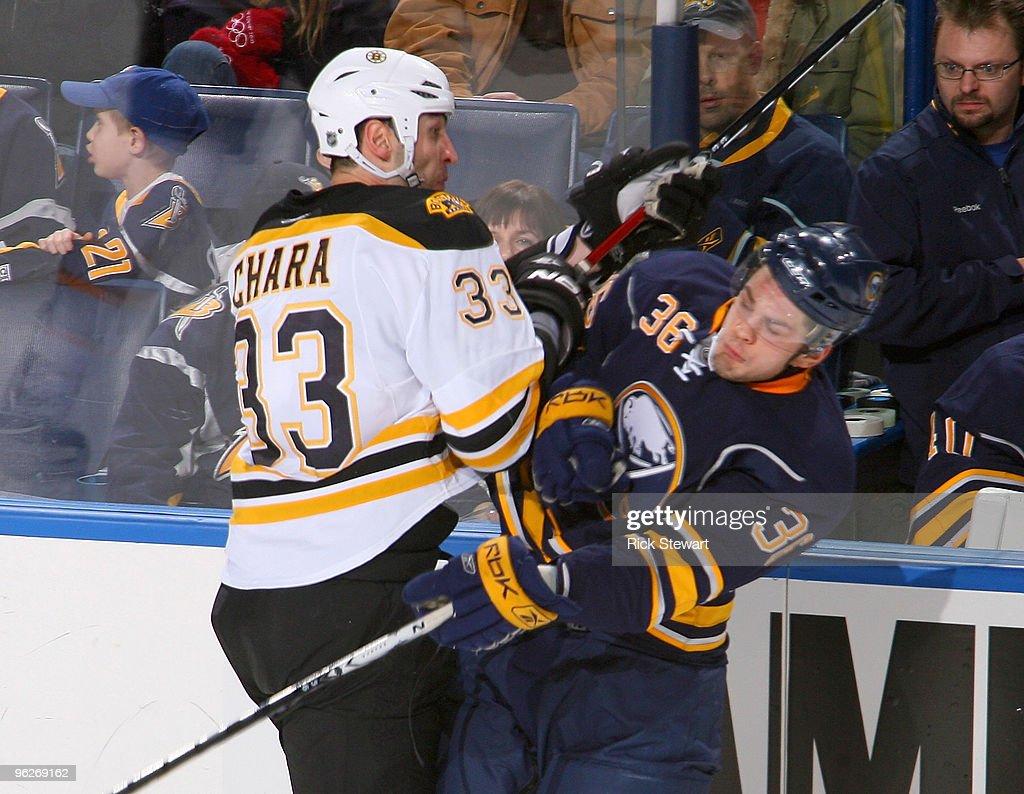 Zdeno Chara #33 of the Boston Bruins checks Patrick Kaleta #36 of the Buffalo Sabres at HSBC Arena on January 29, 2010 in Buffalo, New York.
