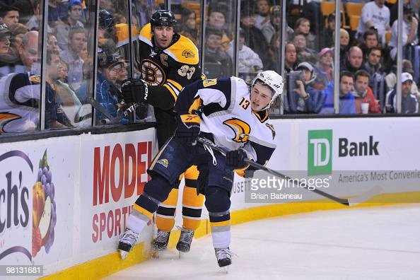 Zdeno Chara of the Boston Bruins checks Tim Kennedy of the Buffalo Sabres at the TD Garden on March 29 2010 in Boston Massachusetts