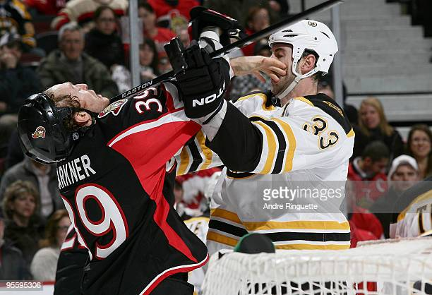 Zdeno Chara of the Boston Bruins cross checks Matt Carkner of the Ottawa Senators at Scotiabank Place on January 5 2010 in Ottawa Ontario Canada