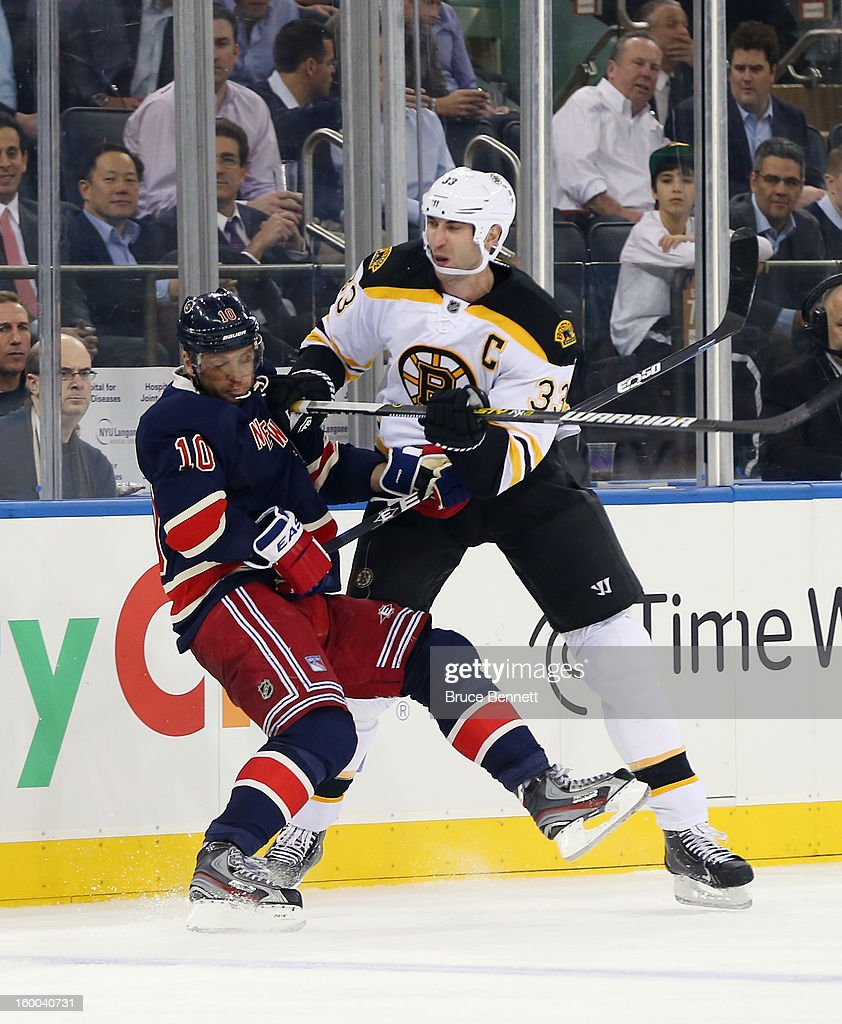 Zdeno Chara #33 of the Boston Bruins dumps Marian Gaborik #10 of the New York Rangers at Madison Square Garden on January 23, 2013 in New York City. The Rangers defeated the Bruins 4-3 in overtime.