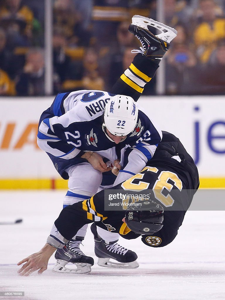 <a gi-track='captionPersonalityLinkClicked' href=/galleries/search?phrase=Zdeno+Chara&family=editorial&specificpeople=203177 ng-click='$event.stopPropagation()'>Zdeno Chara</a> #33 of the Boston Bruins fights <a gi-track='captionPersonalityLinkClicked' href=/galleries/search?phrase=Chris+Thorburn&family=editorial&specificpeople=2222066 ng-click='$event.stopPropagation()'>Chris Thorburn</a> #22 of the Winnipeg Jets in the first period during the game at TD Garden on January 4, 2014 in Boston, Massachusetts.