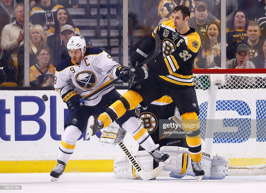 Zdeno Chara #33 of the Boston Bruins fights for position in front of the net against Steve Ott #9 of the Buffalo Sabres in the third period during the game at TD Garden on December 21, 2013 in Boston, Massachusetts.