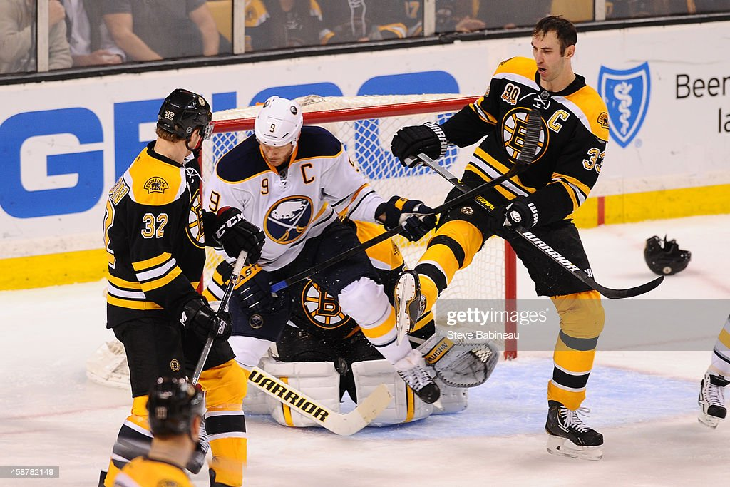 <a gi-track='captionPersonalityLinkClicked' href=/galleries/search?phrase=Zdeno+Chara&family=editorial&specificpeople=203177 ng-click='$event.stopPropagation()'>Zdeno Chara</a> #33 of the Boston Bruins fights for the puck against <a gi-track='captionPersonalityLinkClicked' href=/galleries/search?phrase=Steve+Ott&family=editorial&specificpeople=210616 ng-click='$event.stopPropagation()'>Steve Ott</a> #9 of the Buffalo Sabres at the TD Garden on December 21, 2013 in Boston, Massachusetts.