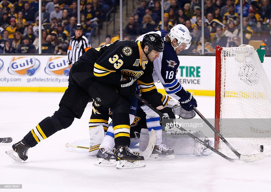 <a gi-track='captionPersonalityLinkClicked' href=/galleries/search?phrase=Zdeno+Chara&family=editorial&specificpeople=203177 ng-click='$event.stopPropagation()'>Zdeno Chara</a> #33 of the Boston Bruins fights for the puck with Byran Little #18 of the Winnipeg Jets in front of the net in the second period during the game at TD Garden on January 4, 2014 in Boston, Massachusetts.