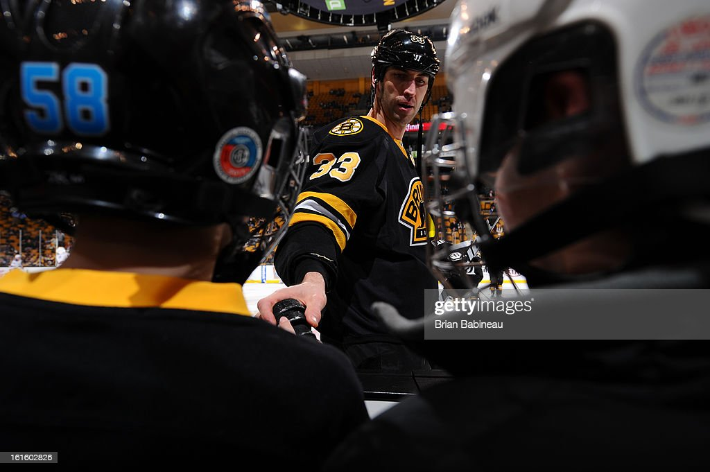 Zdeno Chara #33 of the Boston Bruins hands out a puck to a fan prior to the game against the New York Rangers at the TD Garden on February 12, 2013 in Boston, Massachusetts.
