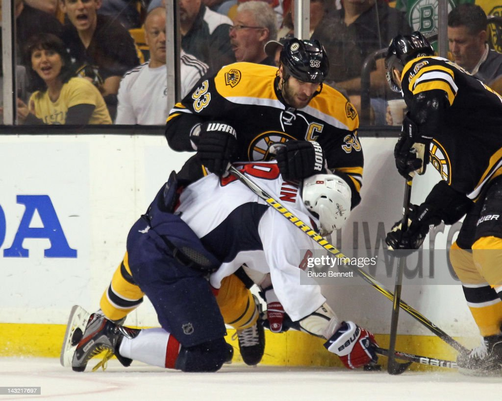 <a gi-track='captionPersonalityLinkClicked' href=/galleries/search?phrase=Zdeno+Chara&family=editorial&specificpeople=203177 ng-click='$event.stopPropagation()'>Zdeno Chara</a> #33 of the Boston Bruins hits Alex Ovechkin #8 of the Washington Capitals along the boards during the first period in Game Five of the Eastern Conference Quarterfinals during the 2012 NHL Stanley Cup Playoffs at TD Garden on April 21, 2012 in Boston, Massachusetts.