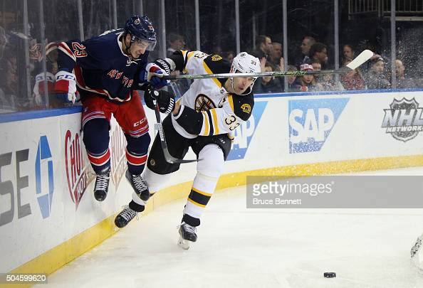 Zdeno Chara of the Boston Bruins hits Jayson Megna of the New York Rangers into the boards during the second period at Madison Square Garden on...