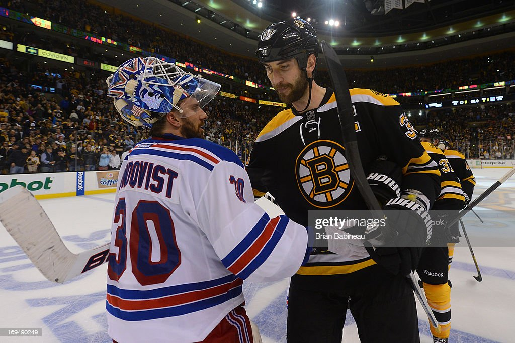 Zdeno Chara #33 of the Boston Bruins hugs Henrik Lundqvist #30 of the New York Rangers after Game Five of the Eastern Conference Semifinals during the 2013 NHL Stanley Cup Playoffs at TD Garden on May 25, 2013 in Boston, Massachusetts.