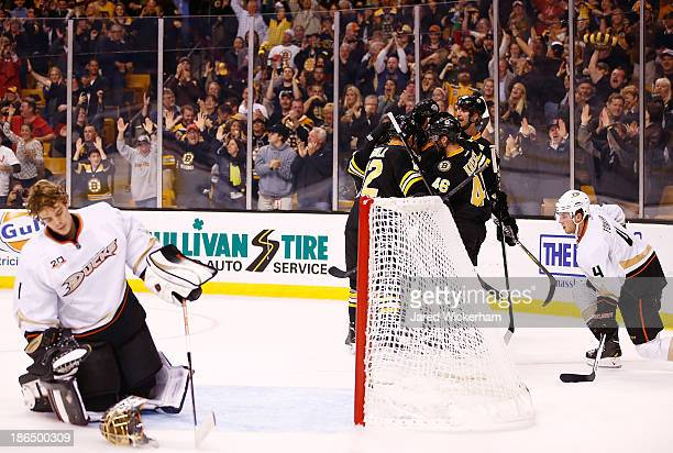 Zdeno Chara of the Boston Bruins is congratulated by teammates after scoring in the third period against the Anaheim Ducks at TD Garden on October 31...