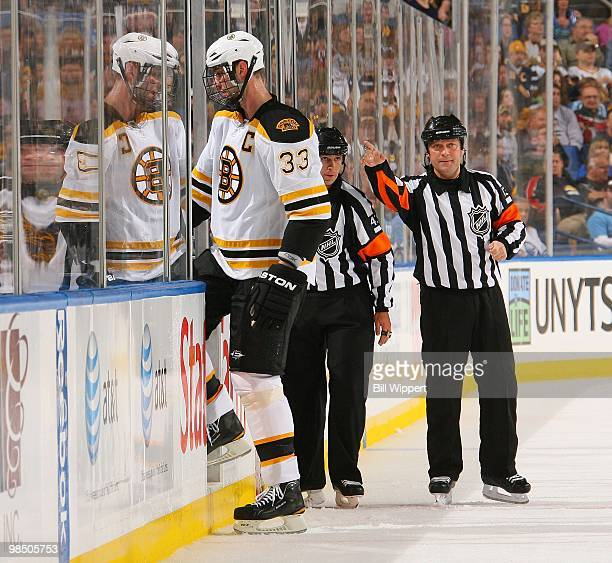 Zdeno Chara of the Boston Bruins is directed to the penalty box by referee Dan O'Halloran in their game against the Buffalo Sabres in Game One of the...