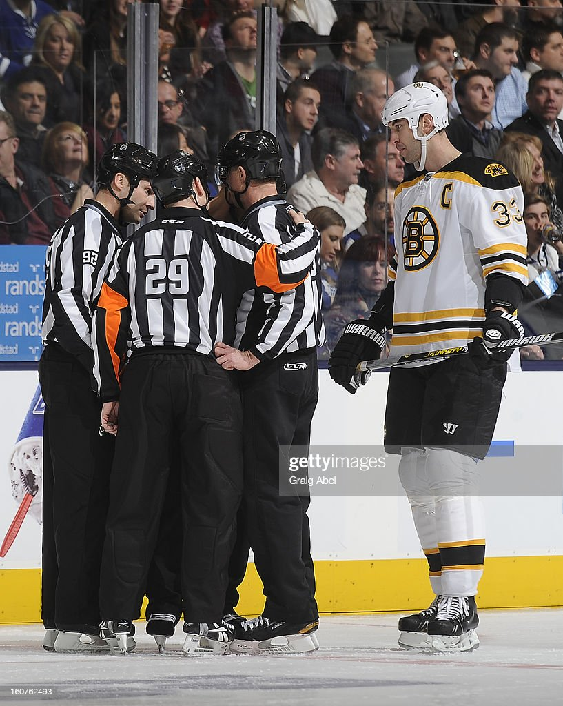 Zdeno Chara of the Boston Bruins listens to the officials during a break in NHL game action against the Toronto Maple Leafs February 2, 2013 at the Air Canada Centre in Toronto, Ontario, Canada.