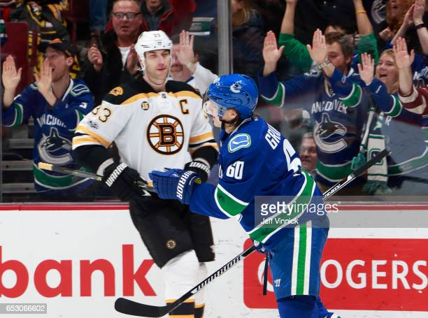 Zdeno Chara of the Boston Bruins looks on as Markus Granlund of the Vancouver Canucks celebrates after scoring during their NHL game at Rogers Arena...