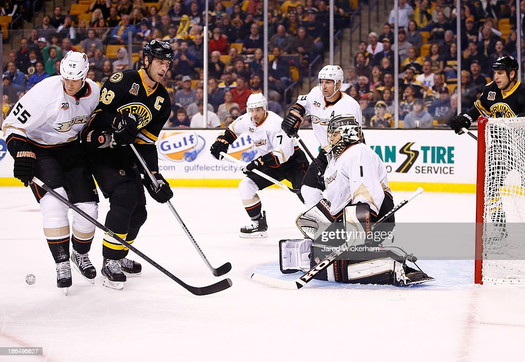Zdeno Chara #33 of the Boston Bruins misses a rebound attempt in the first period in front of Jonas Hiller #1 of the Anaheim Ducks at TD Garden on October 31, 2013 in Boston, Massachusetts.