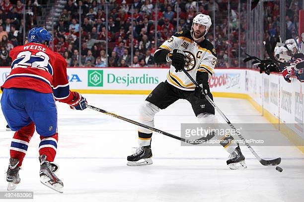Zdeno Chara of the Boston Bruins passes the puck against Dale Weise of the Montreal Canadiens in Game Six of the Second Round of the 2014 NHL Stanley...