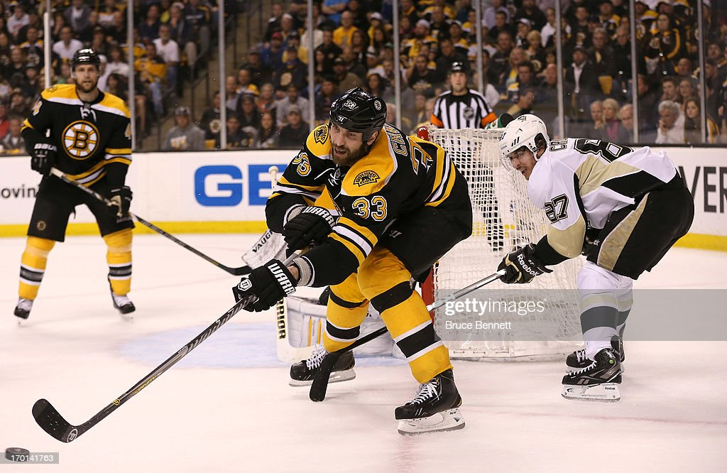 Zdeno Chara #33 of the Boston Bruins passes the puck against Sidney Crosby #87 of the Pittsburgh Penguins in the second period in Game Four of the Eastern Conference Final during the 2013 NHL Stanley Cup Playoffs at the TD Garden on June 7, 2013 in Boston, United States.