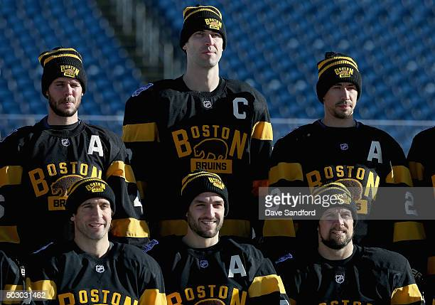 Zdeno Chara of the Boston Bruins poses with teammates before practice for the 2016 Bridgestone NHL Classic at Gillette Stadium on December 31 2015 in...