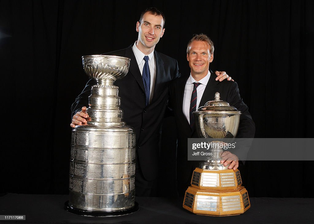 <a gi-track='captionPersonalityLinkClicked' href=/galleries/search?phrase=Zdeno+Chara&family=editorial&specificpeople=203177 ng-click='$event.stopPropagation()'>Zdeno Chara</a> of the Boston Bruins poses with the Stanley Cup and <a gi-track='captionPersonalityLinkClicked' href=/galleries/search?phrase=Nicklas+Lidstrom&family=editorial&specificpeople=201470 ng-click='$event.stopPropagation()'>Nicklas Lidstrom</a> of the Detroit Red Wings poses with the James Norris Memorial Trophy during the 2011 NHL Awards at The Pearl concert theater at the Palms Casino Resort June 22, 2011 in Las Vegas, Nevada.