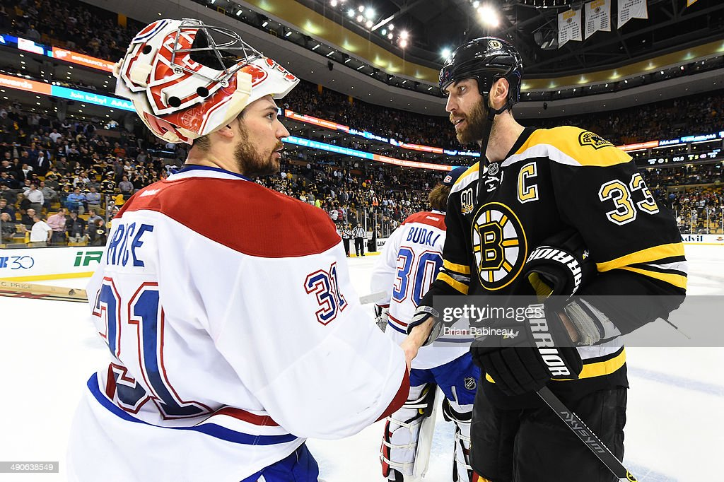 <a gi-track='captionPersonalityLinkClicked' href=/galleries/search?phrase=Zdeno+Chara&family=editorial&specificpeople=203177 ng-click='$event.stopPropagation()'>Zdeno Chara</a> #33 of the Boston Bruins shakes hands with <a gi-track='captionPersonalityLinkClicked' href=/galleries/search?phrase=Carey+Price&family=editorial&specificpeople=2222083 ng-click='$event.stopPropagation()'>Carey Price</a> #31 of the Montreal Canadiens in Game Seven of the Second Round of the 2014 Stanley Cup Playoffs at TD Garden on May 14, 2014 in Boston, Massachusetts.