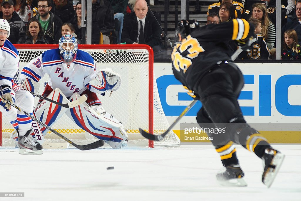 Zdeno Chara #33 of the Boston Bruins shoots the puck against Henrik Lundqvist #30 of the New York Rangers at the TD Garden on February 12, 2013 in Boston, Massachusetts.