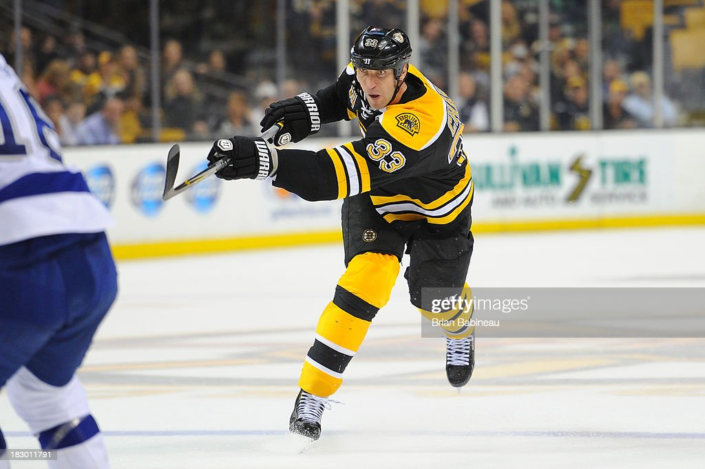 <a gi-track='captionPersonalityLinkClicked' href=/galleries/search?phrase=Zdeno+Chara&family=editorial&specificpeople=203177 ng-click='$event.stopPropagation()'>Zdeno Chara</a> #33 of the Boston Bruins shoots the puck against the Tampa Bay Lightning at the TD Garden on October 3, 2013 in Boston, Massachusetts.