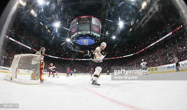 Zdeno Chara of the Boston Bruins shots the puck behind his net in a game against the Montreal Canadiens at the Bell Centre on November 17 2007 in...