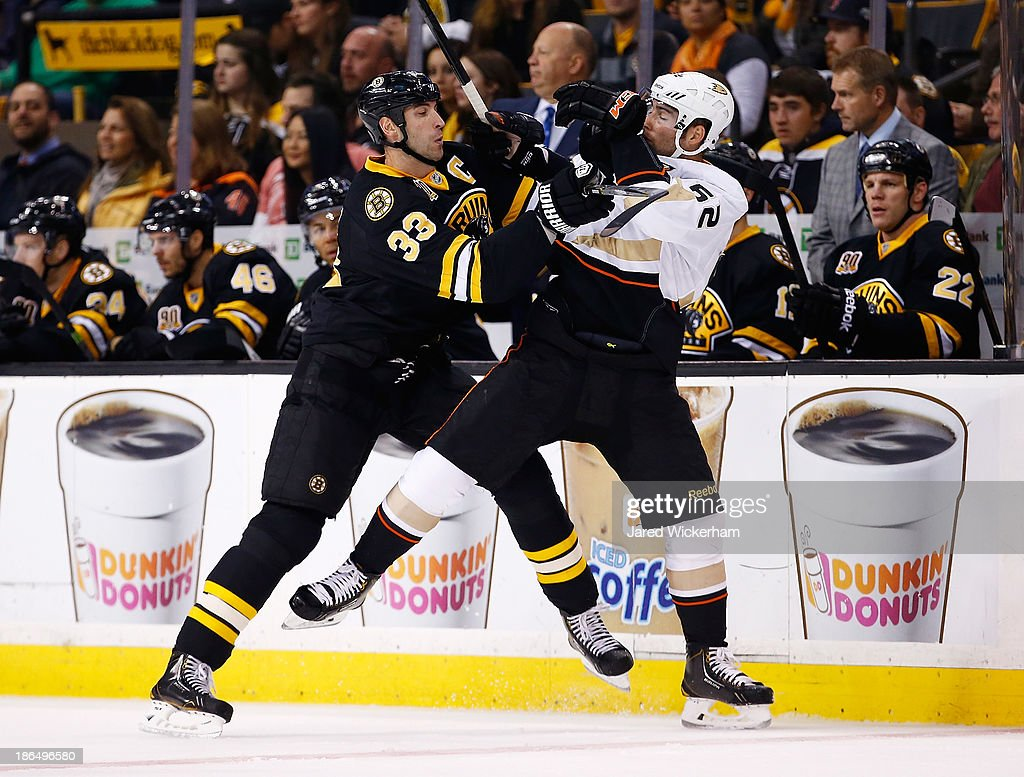 Zdeno Chara #33 of the Boston Bruins shoves Patrick Maroon #62 of the Anaheim Ducks in the first period at TD Garden on October 31, 2013 in Boston, Massachusetts.