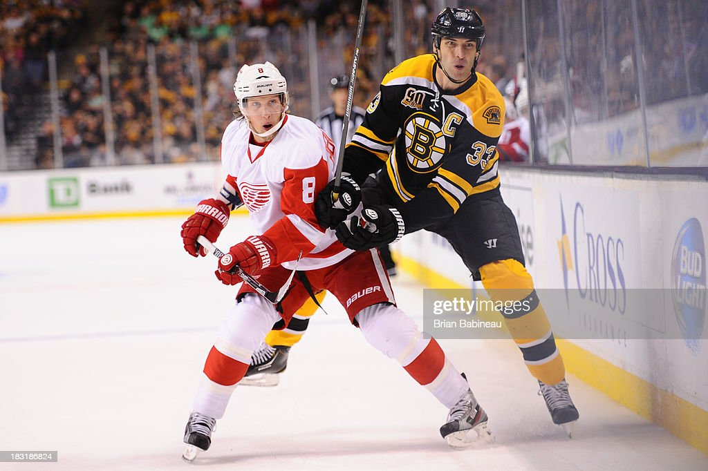 <a gi-track='captionPersonalityLinkClicked' href=/galleries/search?phrase=Zdeno+Chara&family=editorial&specificpeople=203177 ng-click='$event.stopPropagation()'>Zdeno Chara</a> #33 of the Boston Bruins skates against <a gi-track='captionPersonalityLinkClicked' href=/galleries/search?phrase=Justin+Abdelkader&family=editorial&specificpeople=2271858 ng-click='$event.stopPropagation()'>Justin Abdelkader</a> #8 of the Detroit Red Wings at the TD Garden on October 5, 2013 in Boston, Massachusetts.