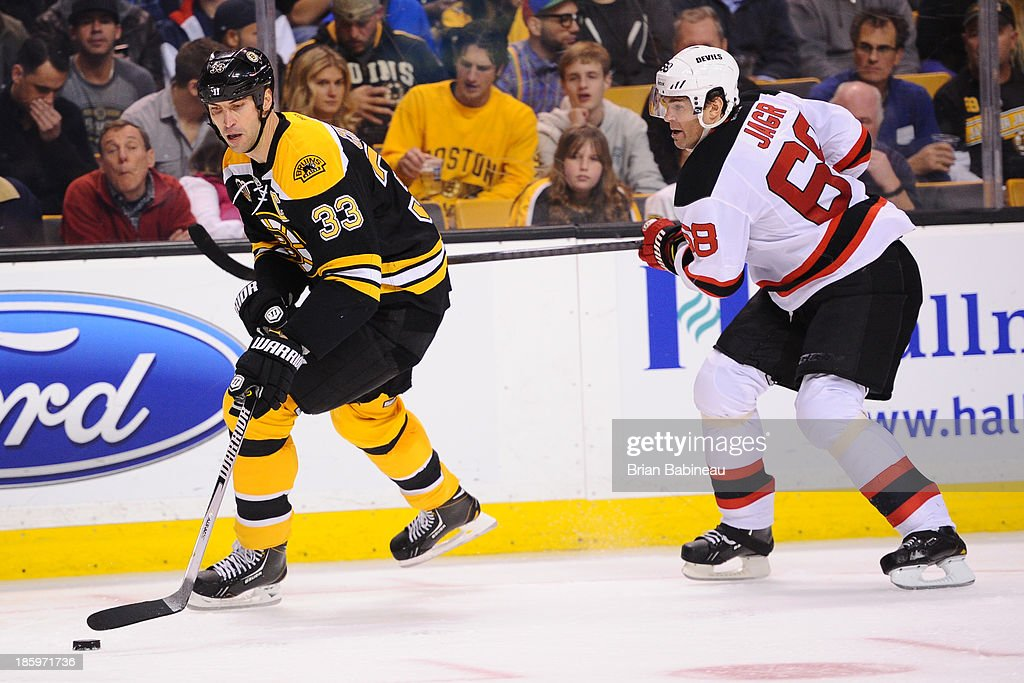 <a gi-track='captionPersonalityLinkClicked' href=/galleries/search?phrase=Zdeno+Chara&family=editorial&specificpeople=203177 ng-click='$event.stopPropagation()'>Zdeno Chara</a> #33 of the Boston Bruins skates with the puck against Jaromir Jagr #68 of the New Jersey Devils at the TD Garden on October 26, 2013 in Boston, Massachusetts.