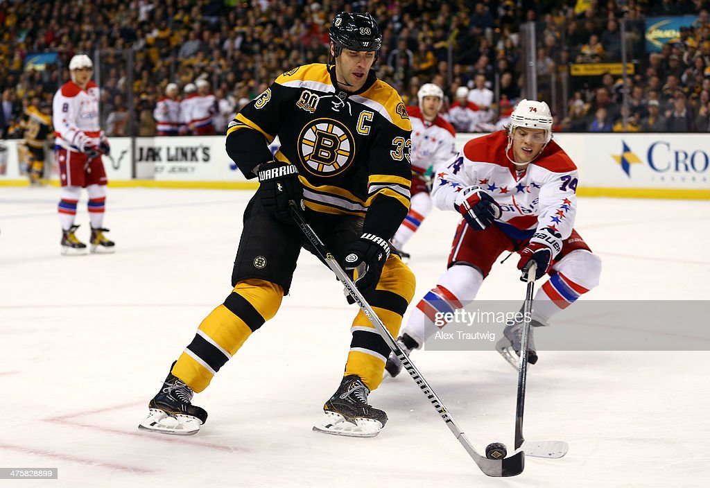 <a gi-track='captionPersonalityLinkClicked' href=/galleries/search?phrase=Zdeno+Chara&family=editorial&specificpeople=203177 ng-click='$event.stopPropagation()'>Zdeno Chara</a> #33 of the Boston Bruins skates with the puck as John Carlson #74 of the Washington Capitals defends during a game at the TD Garden on March 1, 2014 in Boston, Massachusetts.