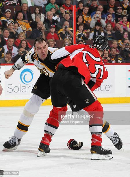 Zdeno Chara of the Boston Bruins throws a punch at Chris Neil of the Ottawa Senators in a fight at Scotiabank Place on February 25 2012 in Ottawa...