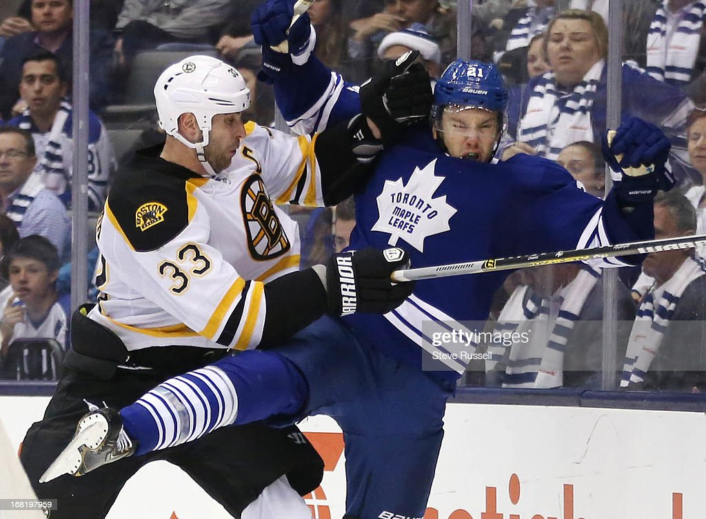 TORONTO, ON- MAY 6 - Zdeno Chara puts a hit on James van Riemsdyk as the Toronto Maple Leafs drop game 3 to the Boston Bruins 5-2 and now trail the first round series 2-1 in the NHL Stanley Cup playoffs at Air Canada Centre in Toronto, May 6, 2013.