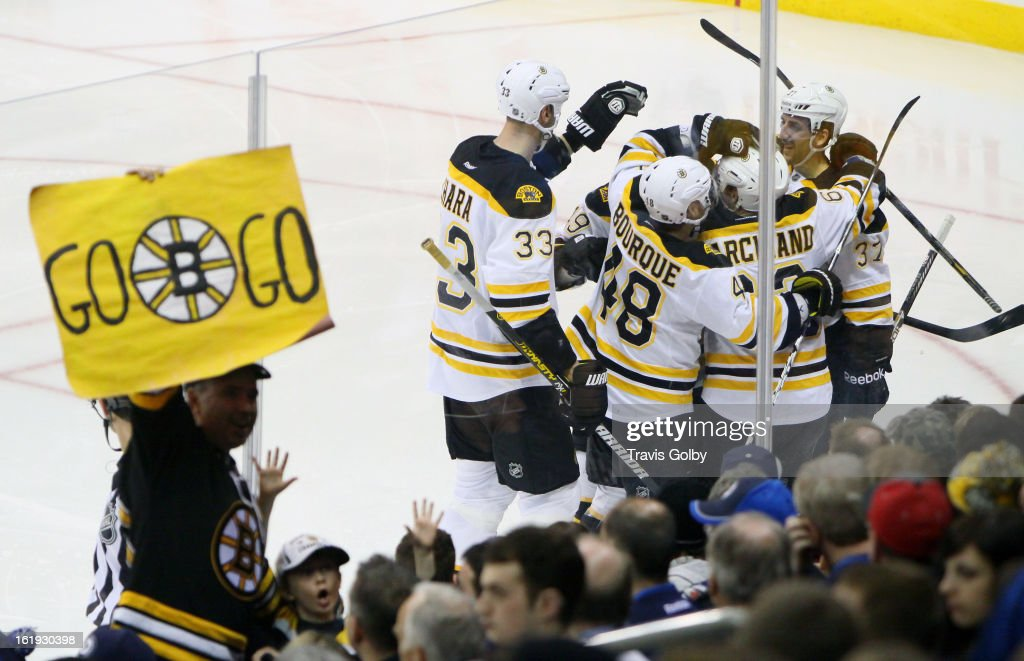 <a gi-track='captionPersonalityLinkClicked' href=/galleries/search?phrase=Zdeno+Chara&family=editorial&specificpeople=203177 ng-click='$event.stopPropagation()'>Zdeno Chara</a> #33, <a gi-track='captionPersonalityLinkClicked' href=/galleries/search?phrase=Rich+Peverley&family=editorial&specificpeople=554442 ng-click='$event.stopPropagation()'>Rich Peverley</a> #49, <a gi-track='captionPersonalityLinkClicked' href=/galleries/search?phrase=Chris+Bourque&family=editorial&specificpeople=716708 ng-click='$event.stopPropagation()'>Chris Bourque</a> #48, <a gi-track='captionPersonalityLinkClicked' href=/galleries/search?phrase=Brad+Marchand&family=editorial&specificpeople=2282544 ng-click='$event.stopPropagation()'>Brad Marchand</a> #63 and <a gi-track='captionPersonalityLinkClicked' href=/galleries/search?phrase=Patrice+Bergeron&family=editorial&specificpeople=204162 ng-click='$event.stopPropagation()'>Patrice Bergeron</a> #37 of the Boston Bruins celebrate a third period goal against the Winnipeg Jets on the ice as a fan celebrates in the stands at the MTS Centre on February 17, 2013 in Winnipeg, Manitoba, Canada.