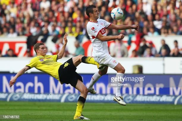 Zdravko Kuzmanovic of Stuttgart is challenged by Sven Bender of Dortmund during the Bundesliga match between VfB Stuttgart and Borussia Dortmund at...