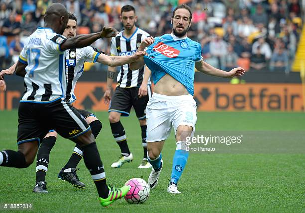 Zdravkob Kuzmanovic and Pablo Estifer Armero of Udinese Calcio compete with Gonzalo Higuain of SSC Napoli during the Serie A match between Udinese...
