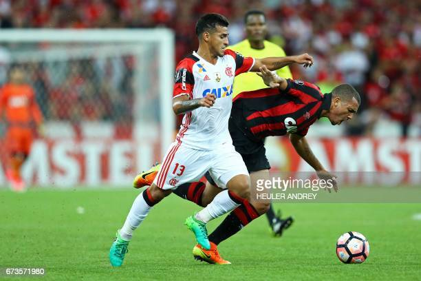 Ze Ivaldo from Brazil's Atletico Paranaense struggles for the ball with Trauco from Brazil's Flamengo during the 2017 Libertadores Cup football match...