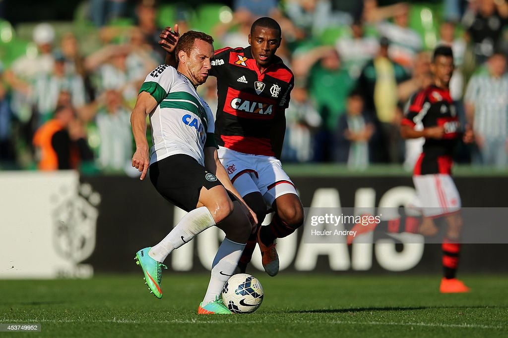 Ze Love of Coritiba competes for the ball with Marcelo of Flamengo during the match between Coritiba and Flamengo for the Brazilian Series A 2014 at Couto Pereira stadium on August 17, 2014 in Curitiba, Brazil.