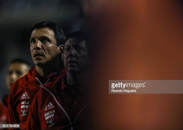 Ze Renato headcoach of Flamengo looks on during the national anhtem prior before the match between Santos and Flamengo as a part of Campeonato...