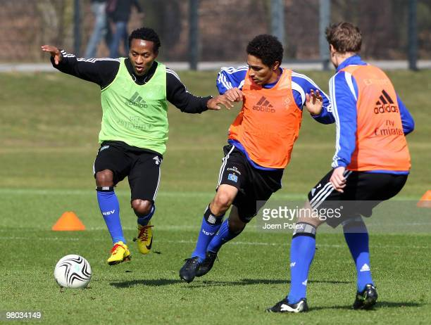 Ze Roberto and Paolo Guerrero of Hamburg compete for the ball during the Hamburger SV training session at the HSH Nordbank Arena on March 25 2010 in...